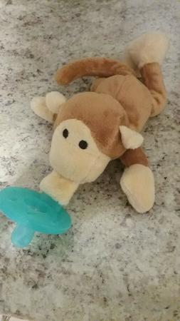 Animal with attached pacifier