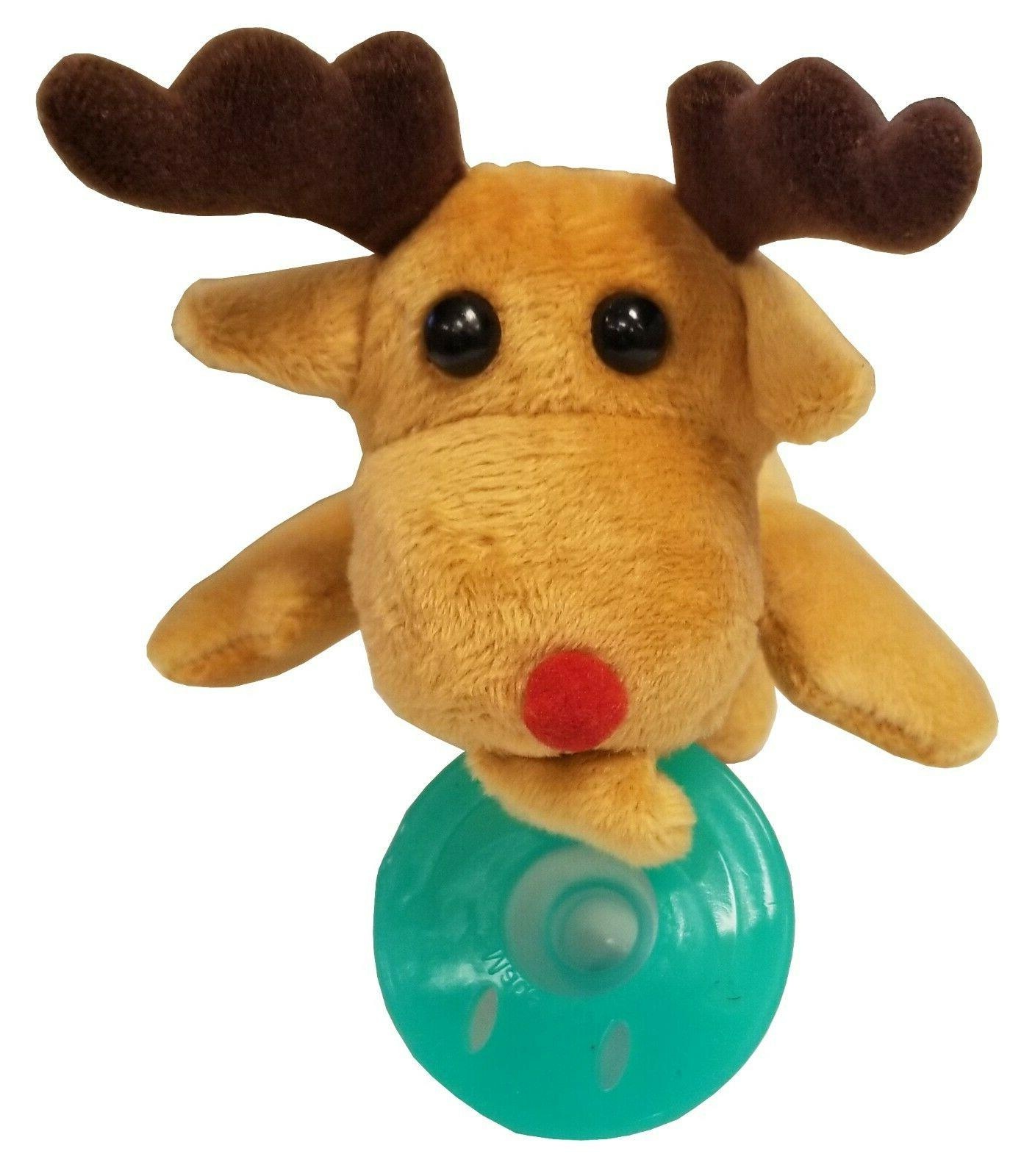 stuffed reindeer with green pacifier